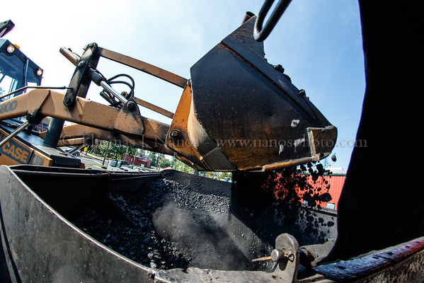 Wayne Hebert operates the backhoe, and tops off No. 40s coal bunker