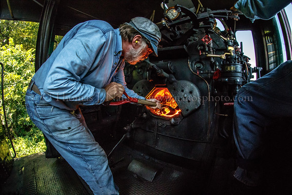Valley Railroad fireman Bill F. throws a shovel full of coal onto No. 40