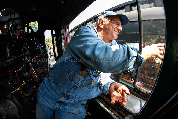 Fred smiles and waves to passengers as No. 40 runs around the train at Deep River Landing