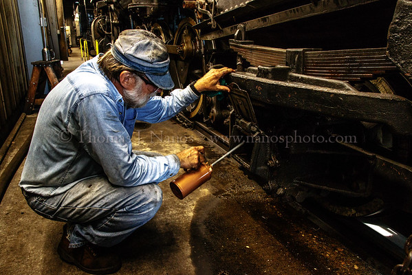 Fireman Bill Frederickson is adding oil to the journal box on the trailing truck of No. 40