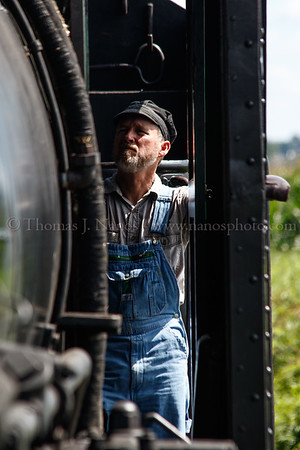 No. 475s fireman watches his gagues in the cab