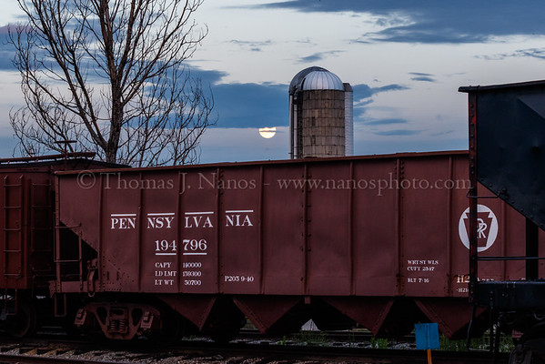 The moon rises over a Pennsylvania hopper