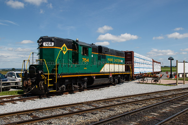 Main Eastern GP9 No 764 spots loaded lumber cars in the transload area of Strasburg