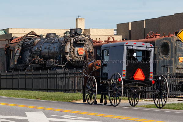 An Amish buggy passes by the outdoor collection at the Railroad Museum of Pennsylvania