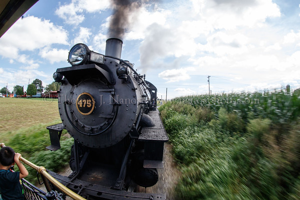 Strasburg rail Road No. 475 pulls the train through conrfields