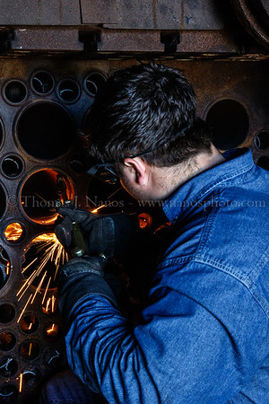 Valley Railroad shop employee Chip begins to cut out 97s superheater tubes