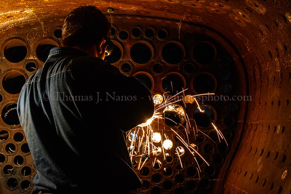 Chip cuts the firebox side of a superheater tube