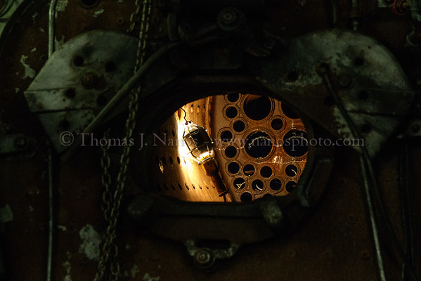 A drop light hangs in 97s firebox