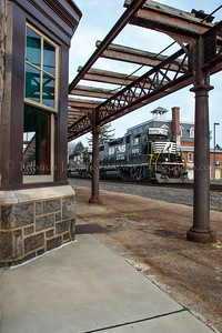 A westbound local Norfolk Southern freight passes by Wernersville, PA station.