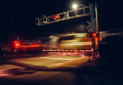 A Connecticut Southern Railroad train crosses Main Street in Manchester, CT while working the Farmer