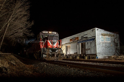 Providence & Worcester train NR-2 rolls by an old feed store in Baltic, Connecticut on the evening of March 18, 2014.