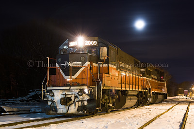 Providence & Worcester train NR-4 pauses in Willimantic yard under a rising moon.