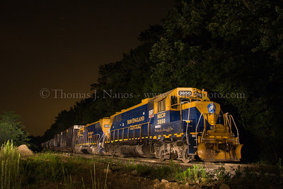 A New England Central freight rests in South Windham, Connecticut. Lighting was done by painting the entire train with a 1,000,000 candlepower flashlight