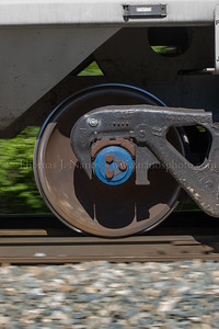 Panning shot of a passing wheel