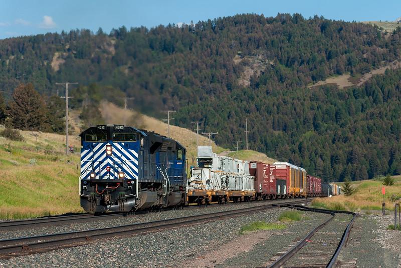 A westbound Montana Rail Link freight nears the summit of Bozeman Pass near Bozeman, Montana on July 19, 2012.