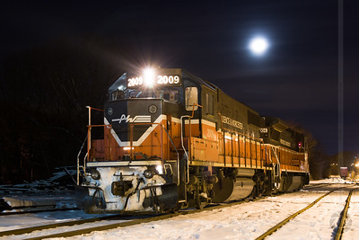 Pausing under the moon Providence & Worcester train NR-4 pauses in Willimantic yard under a rising moon.