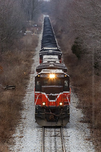 Green Mountain Gateway Coal - A unit coal train traverses the Green Mountain Gateway - a route consisting of the Providence & Worcester, New England Central and Vermont Rail System, connecting to Canadian Pacific.  Here one of the first unit moves over this routing heads north through Franklin, CT on the NECR portion of the route.  The coal originated at the Port of Providence, RI and is destined for a power plant in Johnson City, NY.  Taken on February 4, 2006