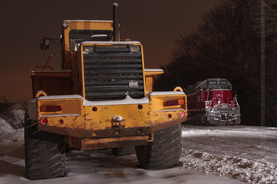 Diesels in the snow A New England Central train sits quietly in the snow alongside a payloader in South Windham, CT