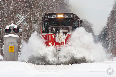 Blasting through Oxford Providence & Worcester train MFS-9, a DOD Extra, blasts through a snow drift in Oxford, MA on their way to the Electric Boat shipyard in Groton, CT