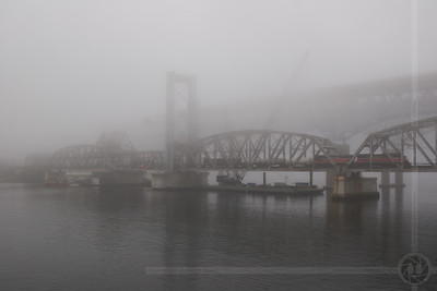 Providence & Worcester train NR-2 crosses the Thames River on a foggy morning