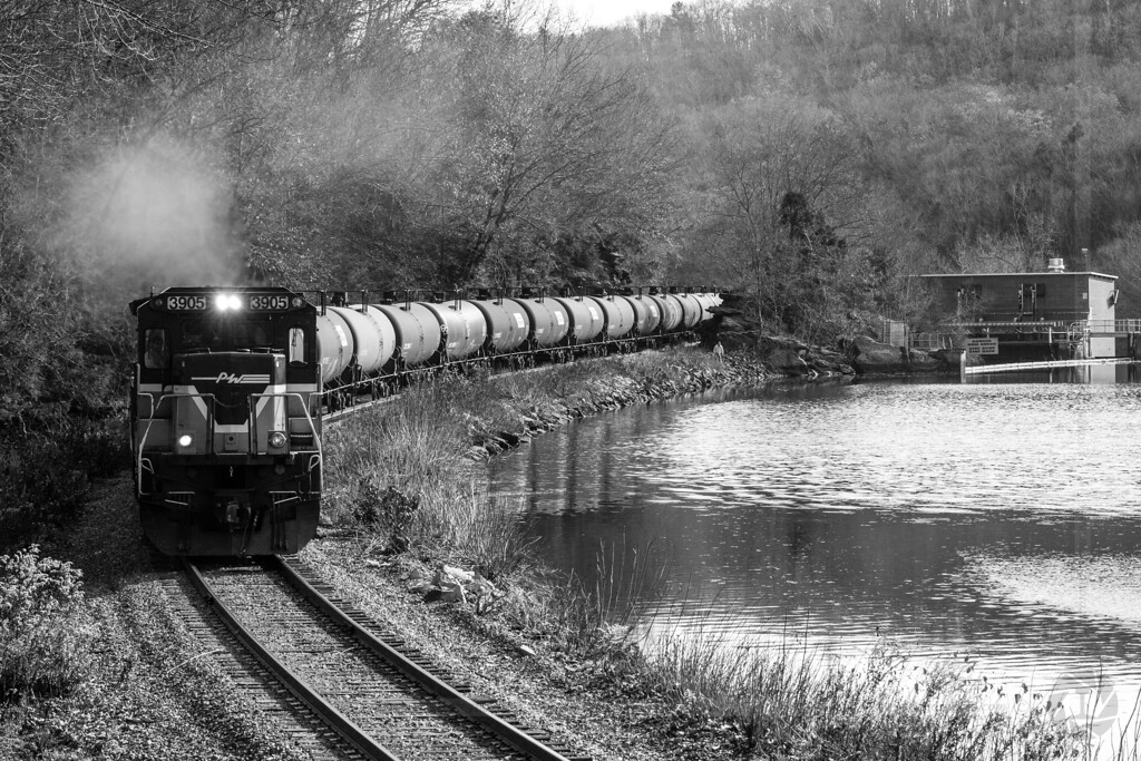 Extra at Scotland Dam<br /> The Providence & Worcester NEC Extra, with 80 empty ethanol tanks in tow, heads west along the Shetucket River and Scotland Dam just after high noon on November 20, 2012