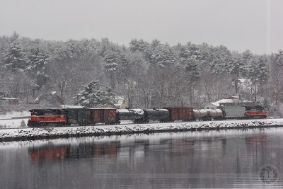Snowy Thames Morning Providence & Worcester train NR-2 rolls south along the Thames River in Ledyard, CT as the snow falls