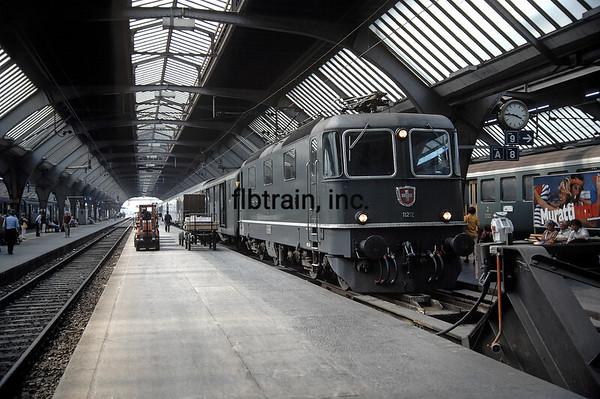 Passengers disembark from an inbound Swiss Railways passenger train.  Zurich, Switzerland, 8/2/1984.