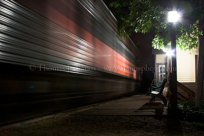 "Rolling through the station. A former New Haven FL-9 and stainless coach ""streak"" past the Chaplin, CT New York, New Haven & Hartford Railroad station.  Yeah, it never really happened before the New Haven's demise, but it did occur at the second CT Eastern RR Museum night photo shoot.  At the end of the night, museum volunteers returned the equipment to their proper locations, and this shot happened as the FL-9 and coaches were returning to their display locations.  June 11, 2005"