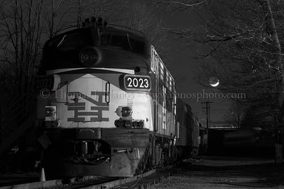 "Sleeping Giant A former New Haven EMD FL-9 sits quietly on the grounds of the Connecticut Eastern Railroad Museum in Willimantic, CT as the crescent moon sets in the background.  This was taken during a test night shoot.  It was the first time I had used studio monolights to light a night scene - this was using two lights - one nearly face on, and the other broadside.  Traditionally we had used a portable Lumedyne flash, which was used to evenly light the scene.  This method enabled the use of shadows to add some depth, and preserve the night ""feel"""