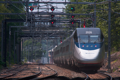 Acela and a High Green A westbound Amtrak Acela heads for Groton Interlocking,which is showing a high green signal