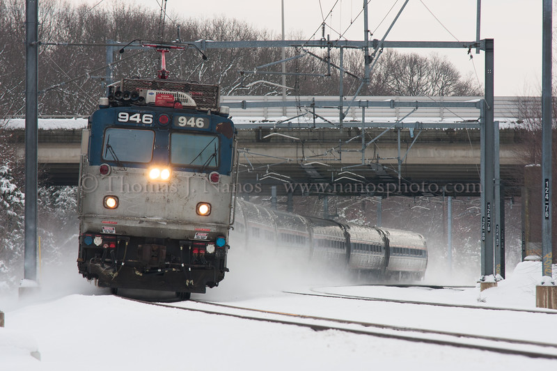 Snowy Regional<br /> A westbound Amtrak Northeast Regional kicks up snow near Groton interlocking in Groton, CT