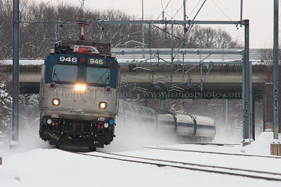 Snowy Regional A westbound Amtrak Northeast Regional kicks up snow near Groton interlocking in Groton, CT
