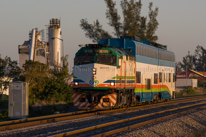 A southbound Tri-Rail commuter train approahces the Delray Beach, FL station on a morning run to Miami.   The train consists of two DMU demonstrators, powered by an F40PH-2C. 2/19/2007
