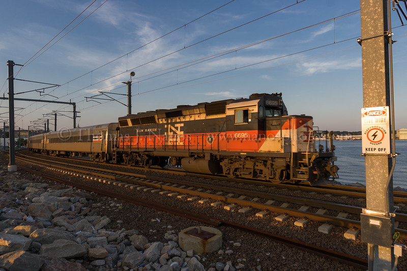New Haven in New London<br /> A Shore Line East commuter train, sporting New Haven painted power, heads west out of New London, CT with commuters heading back towards New Haven, CT