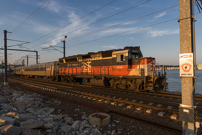 New Haven in New London A Shore Line East commuter train, sporting New Haven painted power, heads west out of New London, CT with commuters heading back towards New Haven, CT