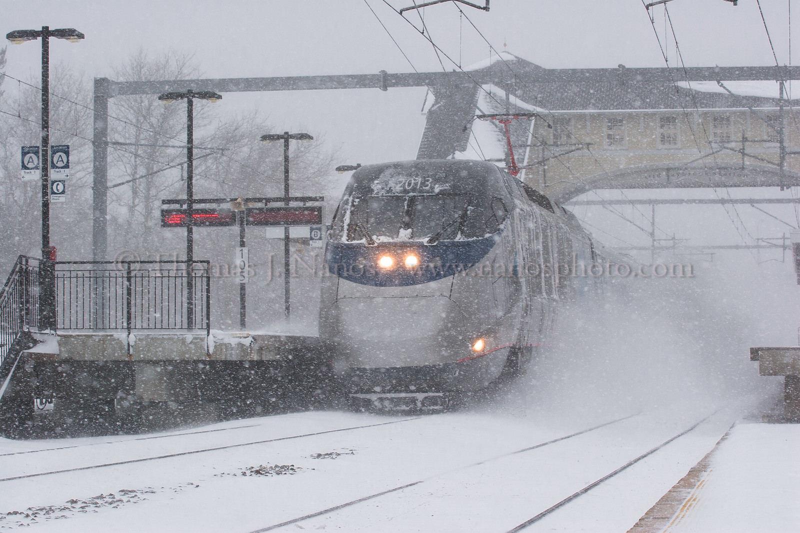 Acela in the Blizzard<br /> A westbound Amtrak Acela blasts through the Old Saybrook, CT station during the blizzard of 2006