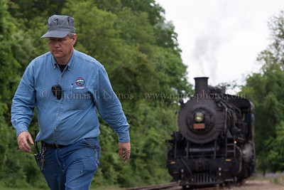 Lerro Productions Valley RR Charter May 2012 The Valley Railroad's David Peters heads back to the crossing in Haddam, CT after lining the switch for No 3025 durring the Lerro Productions photo charter.