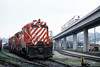 Photo 1056<br /> CP Rail and SkyTrain; New Westminster, British Columbia<br /> May 25, 1986