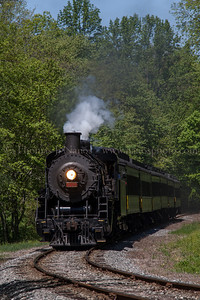 Approaching the crossing Valley Railroad No 3025 pulls their train towards the Old Deep River Road crossing in the Centerbrook section of Essex, CT