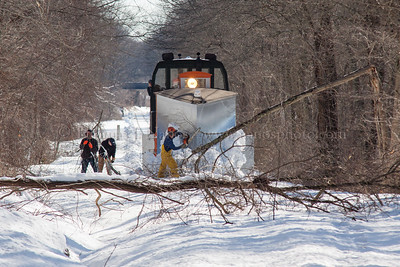 A pair of downed trees stops the plow extra on the Valley Railroad.