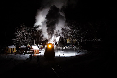 Valley Railroad North Pole Express train NPE-2 pulls into the North Pole on a cold winter night.