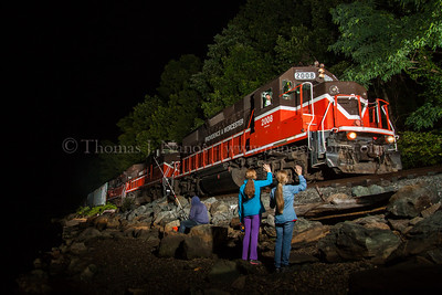 My daughters wave to Providence & Worcester train NR-2 passing by a fisherman in Ledyard, Connecticut