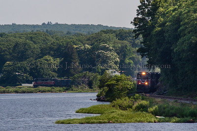 Providence & Worcester train NR-2 snakes its way along the Thames River.  The head end of the train is in Ledyard, while the tail end is still to the north of Poquetanuck Cove in Preston.