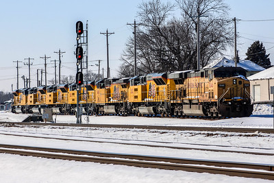 A line of locomotives sit in Missouri Valley, IA on a frigid day.