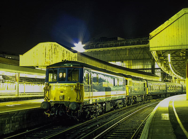 """73109 and 33116 at Waterloo, preparing to work 2Z33, the 20:29 Waterloo - Bournemouth, <br /> on 22nd January 1994. This was to get the stock from the """"Push Pull Farewell"""" back to Bournemouth, and was for invited guests only.  Scanned Transparency."""