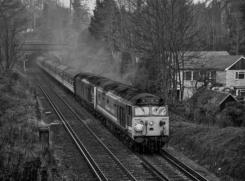 """50030 and 50050 (D400) exiting Chalk Tunnel, Guildford with 1Z25, <br /> the 06:05 Manchester Picadilly - Manchester Picadilly, via Reading, Portsmouth Harbour, Littlehampton, Worthing, Bognor Regis, Eastleigh, Cheltenham Spa <br /> and Birmingham New Street. This was the """"Network Navigator"""" organised <br /> by Pathfinder Tours on 25th January 1992. Scanned Negative."""