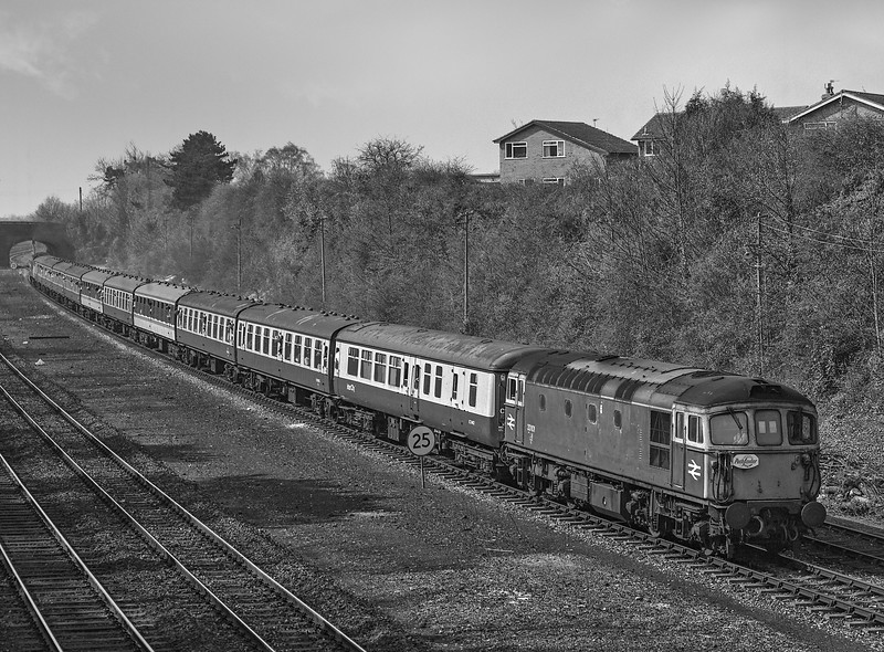 """33101 heading back to Andover from Luidgershall with 1Z37, the 06:21 Manchester - Whatley Quarry and Merehead Quarry, on 31st March 1990. <br /> This was the """"Mendip Quarryman"""" organised by Pathfinder Tours.<br /> 47817 is now on the rear. Scannned Negative."""