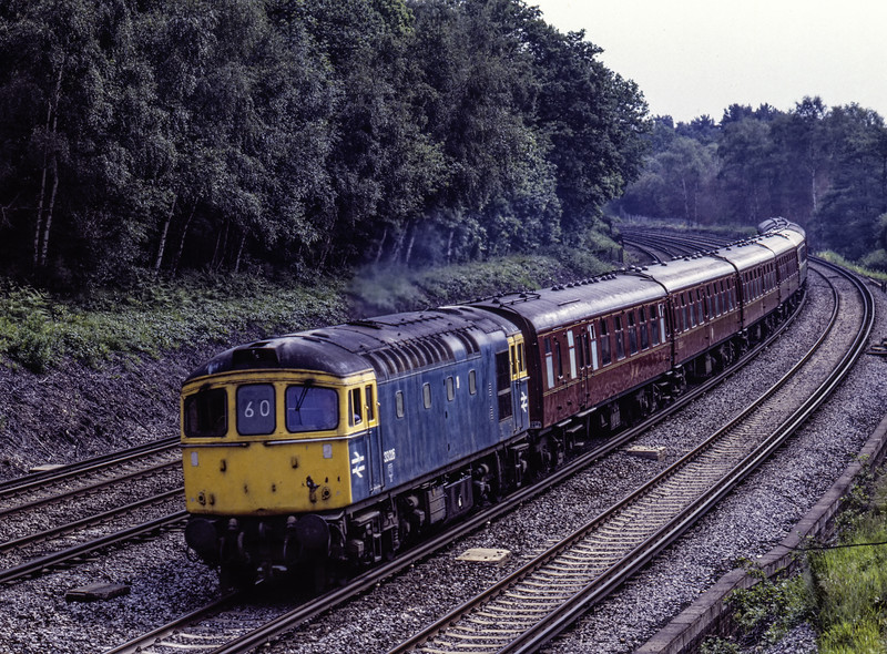 """33026 rounds the curve at Pirbright with the 09:58 Waterloo - Salisbury, <br /> """"Blackmore Vale Express"""" on 13th June 1987. This was a special organised by British Rail, and would feature two return trips from Salisbury to Yeovil Junction, one with <br /> """"Flying Scotsman"""" and the other with """"Clan Line"""" Scanned Transparency."""
