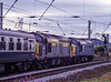 "37047 and 37058 at Warrington Bank Quay with 1Z42, the 12:15 Rylstone Quarry - Reading return railtour, on 17th July 1999. This was the ""Summer Syphony"" <br /> organised by Pathfinder Tours. Scanned Transparency."