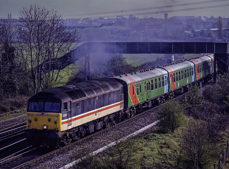 """47853 passes under the footbridge at Didcot North Junction, with 1Z18, <br /> the Didcot Parkway - Manchester Victoria, on 11th April 1992. <br /> This was the """"Great Western Express"""" organised by the Mid Cheshire Rail Users Association. The stock used, was the awful Pilkington liveried  set. Scanned Transparency."""